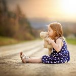 Girl with teddy bear on back road, Rochester, NY