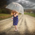 Girl with Umbrella during storm, Rochester, NY