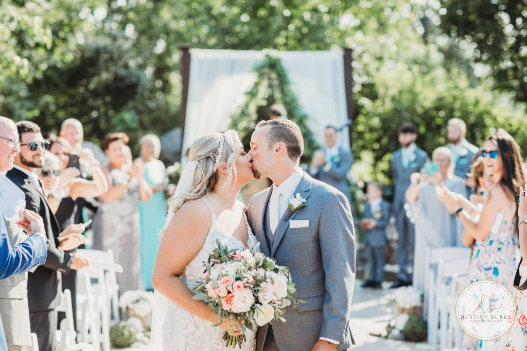 Wedding, photography, couple, kissing, aisle, flowers, Deerfield, Country Club, Brockport, NY